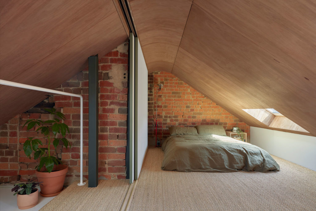 brick wall and timber ceiling
